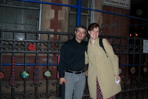 Pianist Louis Menendez and Gretchen outside by the fence, after the performance