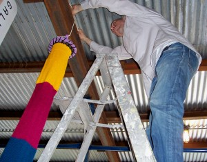 Grey, our intern, installing Brigitte's windsock which came all the way from Germany!  Beautiful!